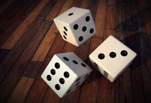 Dice falling on a floor.
