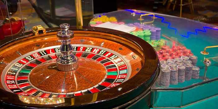 A roulette and chips in a casino.